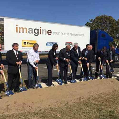 Group breaking construction ground with shovels