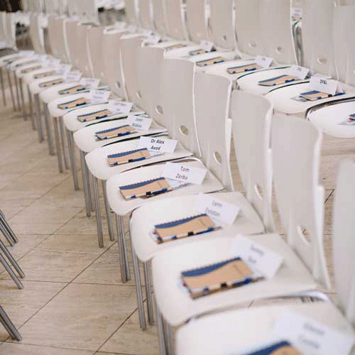 Row of chairs with programs